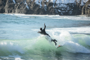 surfer jumping winter surfing vladivostok