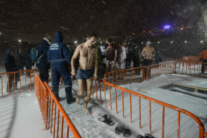 man orthodox epiphany bathing preparations snow blizzard wind vladivostok